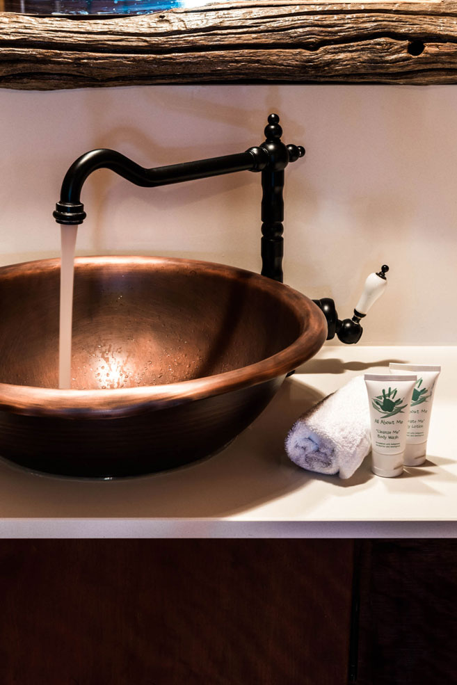 bronze basin in the slab huts bathroom