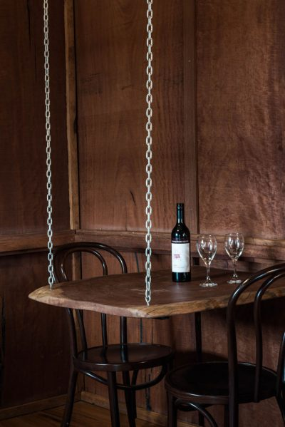 chain hanging table with wine
