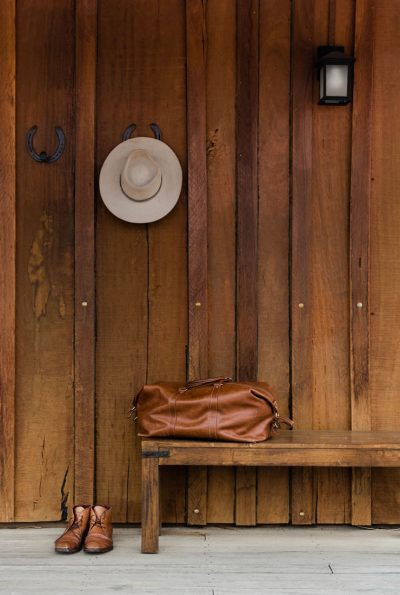 hat bag and shoes outside Slab Huts